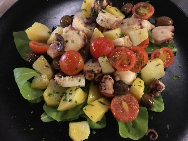 octopus and potato salad with tomatoes & olives