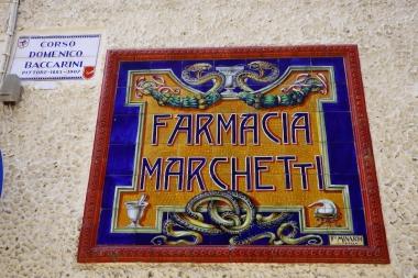 ceramic tile sign on a building
